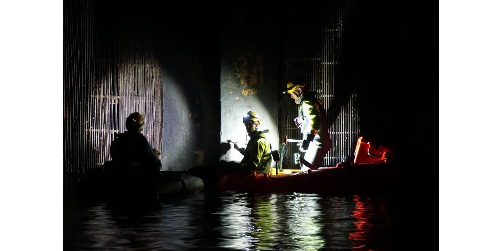 Scan Survey staff working on rafts in the dark