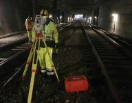 scan survey staff member working with terrain modelling and detailed measurement within a train tunnel
