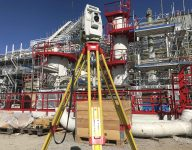 scan survey staff member working with terrain modelling and detailed measurement at a construction site